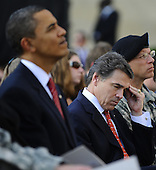 Fort Hood, TX - November 10, 2009 -- Texas Governor Rick Perry wipes his brow as he sits near U.S. President Barack Obama (L) at the memorial service for the 12 soldiers and one civilian killed at Fort Hood U.S Army Post near Killeen, Texas, USA 10 November 2009. Army Major Malik Nadal Hasan reportedly shot and killed 13 people, 12 soldiers and one civilian, and wounded 30 others in a rampage 05 November at the base's Soldier Readiness Center where deploying and returning soldiers undergo medical screenings. .Credit: Tannen Maury / Pool via CNP