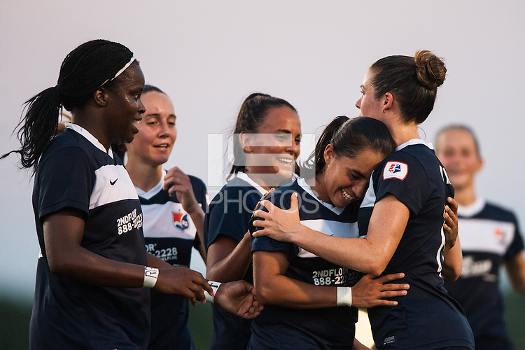 Sky Blue FC forward Monica Ocampo (8) celebrates scoring with teammates. Sky Blue FC defeated the Washington Spirit 1-0 during a National Women's Soccer League (NWSL) match at Yurcak Field in Piscataway, NJ, on July 6, 2013.