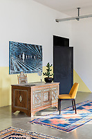 A converted shoe factory blends old world flavour with warehouse edge. A mother-of-pearl inlaid desk from Cairo and an 18th century mother-of-pearl inlaid chair from Damascus. A painting by Alfred Tarazi hangs on the wall.