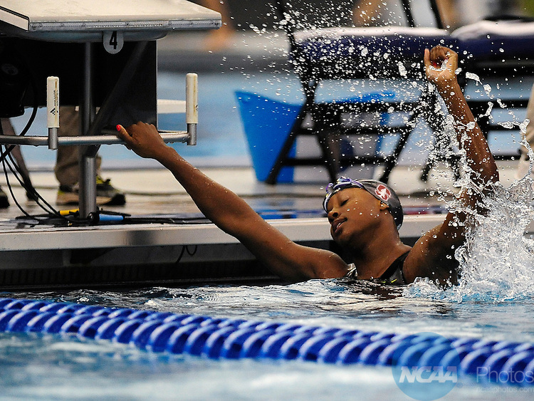 21 MAR 2015: Simone Manuel of Stanford reacts to winning the 100-yard freestyle during the Division I Women's Swimming & Diving Championship at the Greensboro Aquatic Center in Greensboro, NC. Jeffrey A. Camarati/NCAA Photos