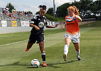 BOYDS, MARYLAND - July 22, 2012:  Lianne Sanderson (10) of DC United Women crosses the ball past Sarah Ann Waugh (3) of the Charlotte Lady Eagles during the W League Eastern Conference Championship match at Maryland Soccerplex, in Boyds, Maryland on July 22. DC United Women won 3-0.