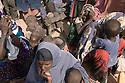 Kenya - Dadaab - Somali refugees who have just arrived at Dadaab refugee camp wait for registration at the UNHCR office.