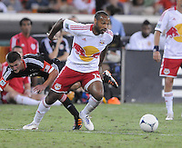 New York Red Bulls forward Thierry Henry (14) shields the ball from D.C. United midfielder Perry Kitchen (23)  The New York Red Bulls tied D.C. United 2-2 at RFK Stadium, Wednesday August 29, 2012.