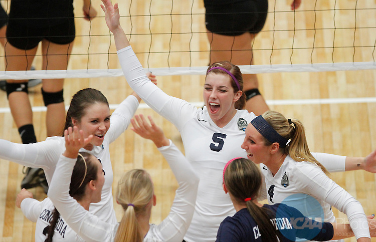 14 DEC 2013 Concordia-St. Paul celebrates a point during the Division II Women's Volleyball Championship game held at the U.S. Cellular Center in Cedar Rapids, IA.  Concordia-St. Paul won over BYU-Hawaii in 3 straight sets to claim the championship title.   <br />