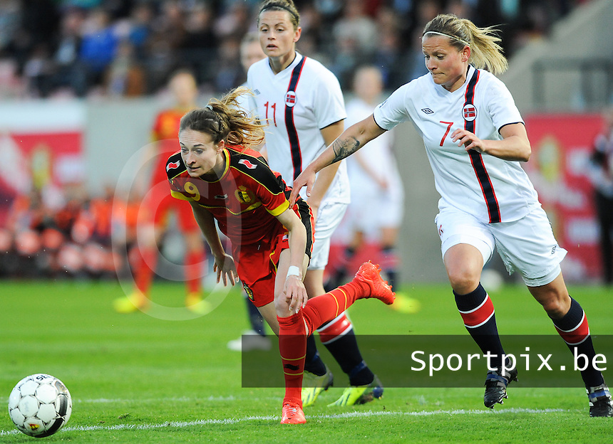 20140410 - LEUVEN , BELGIUM : Norwegian Trine Ronning (7) pictured with Belgian Tessa Wullaert (9)  during the female soccer match between Belgium and Norway, on the seventh matchday in group 5 of the UEFA qualifying round to the FIFA Women World Cup in Canada 2015 at Stadion Den Dreef , Leuven . Thursday 10th April 2014 . PHOTO DIRK VUYLSTEKE