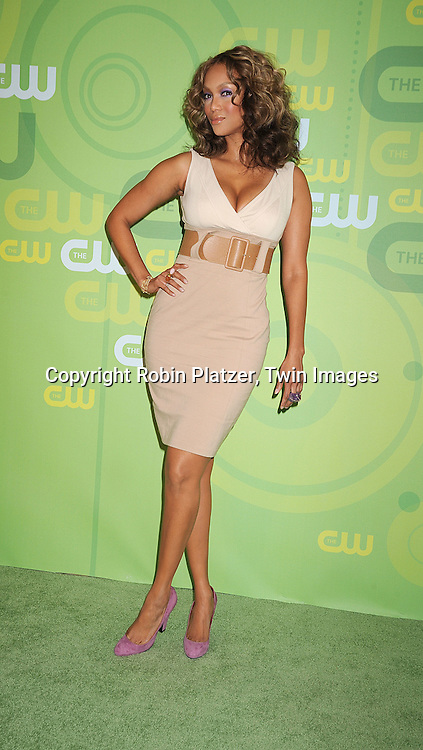Tyra Banks ..posing for photographers at The CW Upfront Announcement of their 2008-2009 Fall Season on May 13, 2008 at Lincoln Center.....Robin Platzer, Twin Images