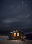 Yellowstone National Park, WY: Cabin at the Lamar Buffalo Ranch with winter night sky.
