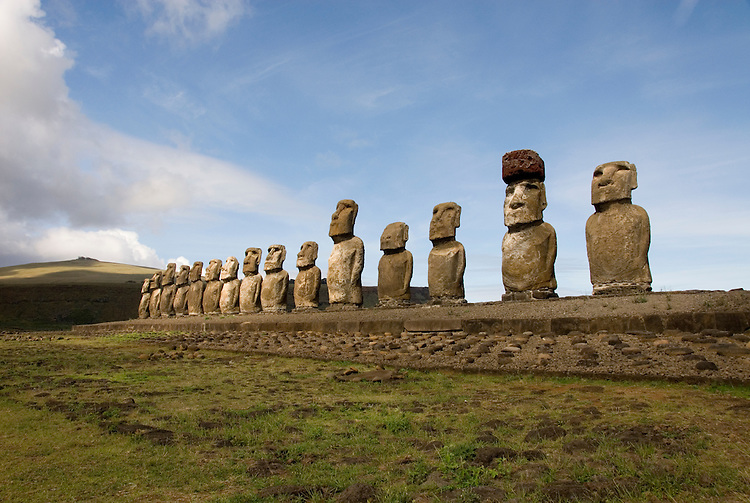 Chile, Easter Island: Array of statues or moai on a platform or ahu at Ahu Tongariki, near the quarry Rano Raruku.  This is the largest array of moia on Easter Island, consisting of 15 moai..Photo #: ch239-32718..Photo copyright Lee Foster www.fostertravel.com lee@fostertravel.com 510-549-2202