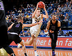 BROOKINGS, SD - NOVEMBER 6: Mike Daum #24 from South Dakota State University drives the lane between Trey Drechsel #2 and Michael Finke #43 from Grand Canyon University during their game Tuesday night at Frost Arena in Brookings, SD. (Photo by Dave Eggen/Inertia)