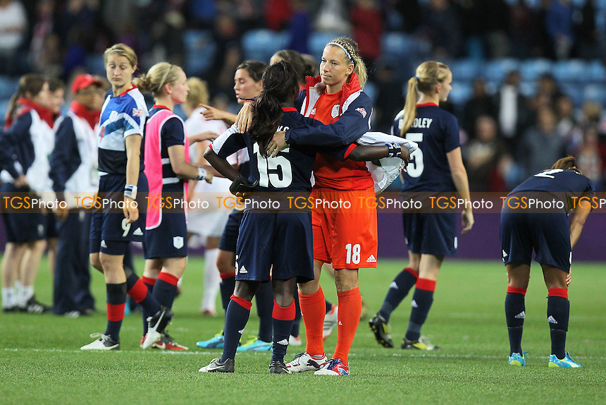 Rachel Brown of GB hugs Eniola Aluko at the final whistle - Great Britain Women vs Canada Women - Womens Olympic Football Tournament London 2012 Quarter-Final at the City of Coventry Stadium - 03/08/12 - MANDATORY CREDIT: Gavin Ellis/SHEKICKS/TGSPHOTO - Self billing applies where appropriate - 0845 094 6026 - contact@tgsphoto.co.uk - NO UNPAID USE.