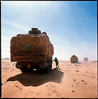 Sahara desert, Chad, December 2004..Every week, a convoy of 40 privately owned Libyan trucks loaded by the WFP with about 1000 metric tons of western food aid cross 2500 km of deep desert across Libya and Chad to reach more than 200 000 refugees from Darfur in camps near the Sudanese border.