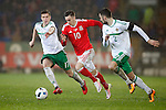 Tom Lawrence of Wales and Patrick McNair of Northern Ireland during the international friendly match at the Cardiff City Stadium. Photo credit should read: Philip Oldham/Sportimage