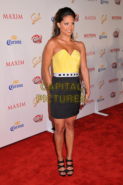VANESSA MINNILLO.The Maxim's Hot 100 List Party held at Barker Hangar in Santa Monica, California, USA..May 13th, 2009 .full length black skirt yellow strapless top sandals clutch bag silver hand in pocket fishnet net netting sandals shoes .CAP/ADM/BP.©Byron Purvis/AdMedia/Capital Pictures.
