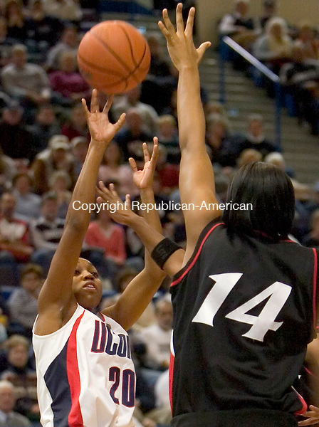 HARTFORD --19 JANUARY-011908JS09-UConn's Renee Montgomery puts up a shot over Cincinnati's Emy Ogide during their game Saturday at the XL Center in Hartford. Montgomery finished with  a game-high 27 points in their 86-49 win over the Bobcats. <br />  Jim Shannon/Republican-American