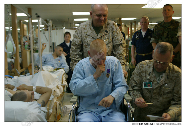 20 year old Marine CPL Michael Mead, and other patients who were wounded in the battle of  Nasaryia, recieve  Purple Hearts. USNS COMFORT Naval hospital ship in the Persian Gulf.