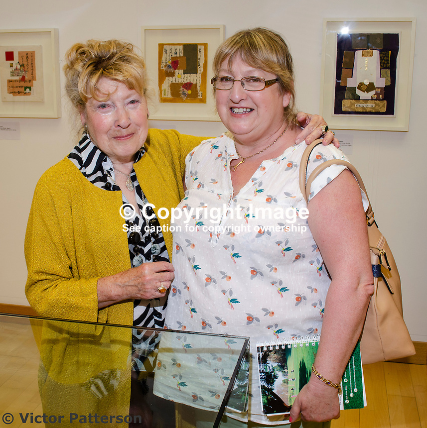 "Mavis Thomson, artist, right, with married sister, Barbara Wilson. Mavis, who lives in Enniskillen, Co Fermanagh, N Ireland, is a member of the Royal Ulster Academy, Ulster Society of Woman Artists, Watercolour Society of Ireland, Ulster Watercolour Society and the Turner Society. Taken at art exhibition, ""Three Ways of Seeing"", in the Strule Arts Centre, Omagh, Co Tyrone, 25th May 2018. The event showcased the work of not just Mavis, but her equally talented daughters, Marion and Sydney. 201805254880<br />