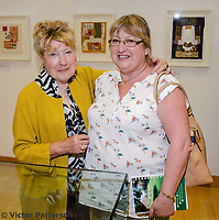 Mavis Thomson, artist, right, with married sister, Barbara Wilson. Mavis, who lives in Enniskillen, Co Fermanagh, N Ireland, is a member of the Royal Ulster Academy, Ulster Society of Woman Artists, Watercolour Society of Ireland, Ulster Watercolour Society and the Turner Society. Taken at art exhibition, &ldquo;Three Ways of Seeing&rdquo;, in the Strule Arts Centre, Omagh, Co Tyrone, 25th May 2018. The event showcased the work of not just Mavis, but her equally talented daughters, Marion and Sydney. 201805254880<br />