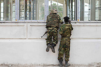 Members of AMISOM (African Mission in Somalia) peer through the windows of Parliament House during the siege.