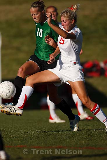 Salt Lake City - Provo's Amber Wadsworth (left) and East's Kinsey Grant. East defeats Provo High School girls soccer 3-0 in a playoff game at East, Tuesday, October 14, 2008. ; 10.14.2008. provo's amber wadsworth, east's kinsey grant