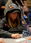 Team Pokerstars.net Pro Vanessa Rousso sees  the bad news as the cards hit the board.  She was eliminated in 10th. place.