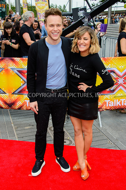 WWW.ACEPIXS.COM<br /> <br /> July 16 2015, London<br /> <br /> Olly Murs and Caroline Flack at the Red Carpet arrivals for The X Factor Auditions  at Wembley Arena on the July 16, 2015 in London<br /> By Line: Famous/ACE Pictures<br /> <br /> <br /> ACE Pictures, Inc.<br /> tel: 646 769 0430<br /> Email: info@acepixs.com<br /> www.acepixs.com