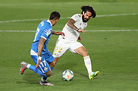 2nd July 2020, Madrid, Spain;  Real Madrid s Isco Alarcon R vies with Getafe s Mathias Olivera during a Spanish league football match between Real Madrid and Getafe in Madrid, Spain