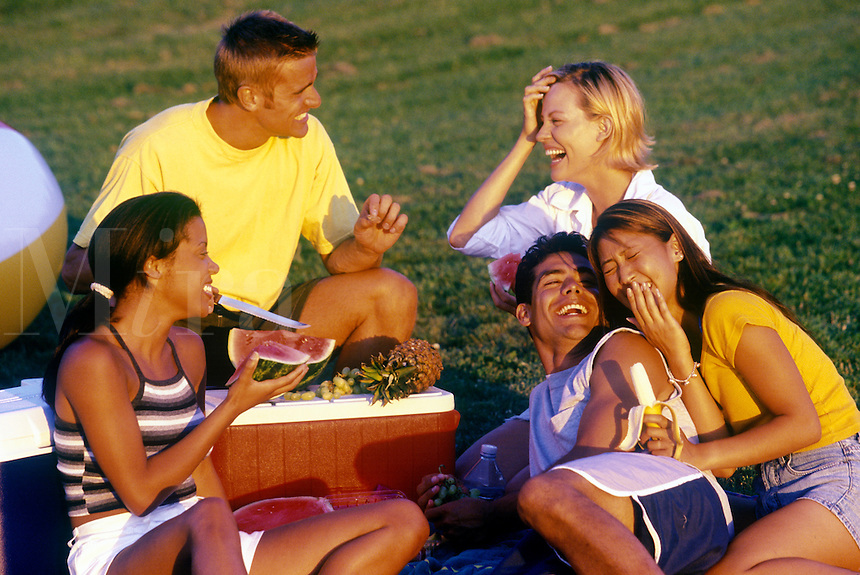 Young adults enjoying a picnic.