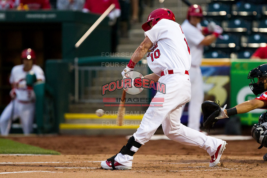Aaron Luna (10) of the Springfield Cardinals makes contact on a pitch during a game against the Frisco RoughRiders on April 14, 2011 at Hammons Field in Springfield, Missouri.  Photo By David Welker/Four Seam Images.