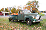 Pumpkins for sale in an old Chevrolet pickup truck at a roadside stand in Vermont, New England, United States of America, North America