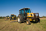 New Holland TL100A (2002), Johne Deere 5510 (2000), Massey Ferguson 4253 (1998), and Ford mowing the highway right-of-way,
