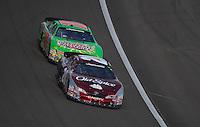 Mar 1, 2008; Las Vegas, NV, USA; Nascar Nationwide Series driver Tony Stewart (20) leads Kyle Busch (18) during the Sams Town 300 at the Las Vegas Motor Speedway. Mandatory Credit: Mark J. Rebilas-US PRESSWIRE