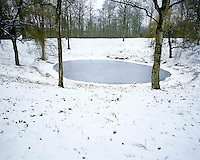 A frozen pond in Caterpillar Crater. It was formed during World War I by a mine detonated benath German postions in October 1916. During World War I the area was part of the Ypres Salient the site of many battles including the five battles of Ypres, Langemark, Passendale and Messines.