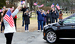WATERBURY CT. 31 December 2018-123118SV07-Flag wavers line East Main Street as the hearse carrying Zeqir &quot;Ziggy the Flag Man&quot; Berisha enters Calvary Cemetery in Waterbury Monday.<br /> Steven Valenti Republican-American
