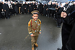 A kid dressed-up as a Syrian soldier stands amongst Druze Sheikhs, during a rally supporting Syrian president Assad, in Majdal Shams, Golan Heights.