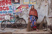 """Paruti, Dalit """"Untouchable"""" Hindu Street Sweeper, Jhenaidah, Bangladesh, 2017<br /> Paruti is a Dalit Hindu, the untouchable caste, working as street sweeper. There are about 5.5 million Dalit across the country, they are considered the most neglected caste in their society, living together in slums and working mostly as street sweepers and toilet cleaners. Paruti makes about 2500 Bangladesh TK a month, or $25. She has four children. Her husband is also a sweeper."""