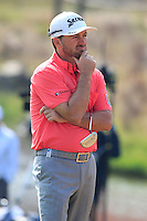Graeme McDowell (NIR) ponders life on the 8th green during Sunday's Final Round of the 2014 BMW Masters held at Lake Malaren, Shanghai, China. 2nd November 2014.<br /> Picture: Eoin Clarke www.golffile.ie