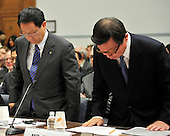 Washington, D.C. - February 24, 2010 --  Akio Toyoda, President and CEO, Toyota Motor Corporation, left, and Yoshimi Inaba, President and CEO, Toyota Motor North America, Inc., right, prepare to sit down after being sworn-in to testify before the U.S. House Committee on Government and Reform examining the Federal government's response to the recall of millions of Toyota vehicles due to reports of malfunctioning gas pedals, and to gain a better understanding of the nature of the sudden acceleration problem in Toyota vehicles and what should be done about it..Credit: Ron Sachs / CNP.(RESTRICTION: NO New York or New Jersey Newspapers or newspapers within a 75 mile radius of New York City)