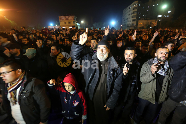 Palestinians supporting Hamas movement take part during a gathering to pay tribute to the brigade's militants who died after a tunnel collapsed in the Gaza Strip on January 31, 2016 in Gaza city. Seven Hamas militants were killed on January 28, 2016 after a tunnel built for fighting Israel collapsed in the Gaza Strip, highlighting concerns that yet another conflict could eventually erupt in the Palestinian enclave. Photo by Mohammed Asad