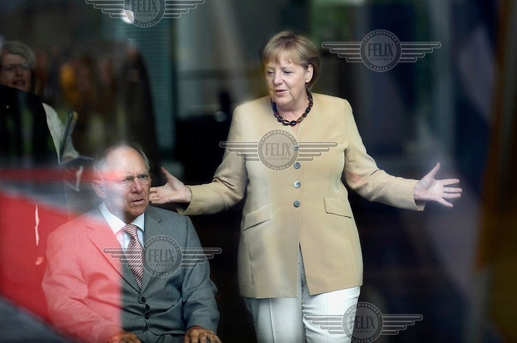 Wolfgang Schaeuble, Federal German Minister of Finance, CDU, and Chancellor Angela Merkel at the Chancellery Office in Berlin.