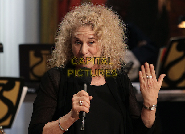 Singer-songwriter Carole King speaks after being awarded the 2013 Library of Congress Gershwin Prize for Popular Song by U.S. President Barack Obama (not pictured) at the White House in Washington, DC on May 22, 2013. .half length black top singing microphone on stage in concert live gig performance performing music .CAP/ADM/CNP/YG.©Yuri Gripas/CNP/AdMedia/Capital Pictures.