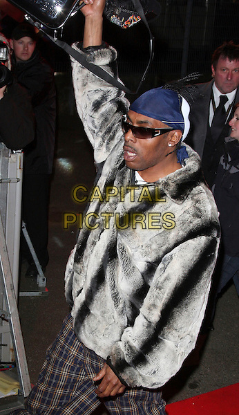 COOLIO .Celebrity Big Brother housemates enter The House Elstree Studios, Borehamwood, Hertfordshire (Herts), England, 2nd January 2009..half length grey gray black fur coat jacket tartan plaid trousers sunglasses at night bag arm raised up  head scarf bandana bandanna.CAP/ROS.©Steve Ross/Capital Pictures