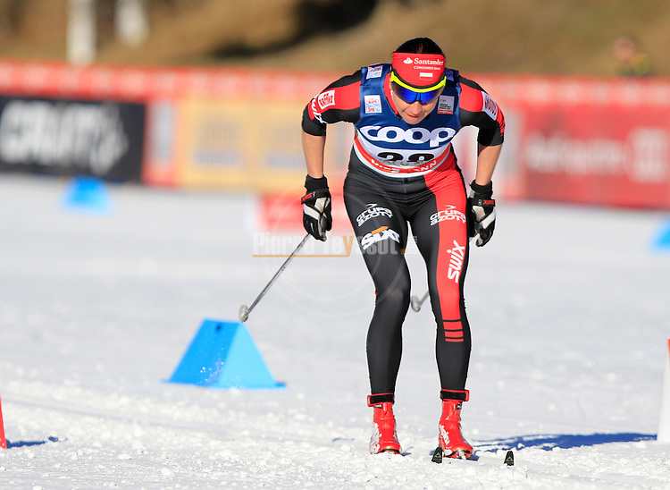 Justyna Kowalczyk competes during the FIS Cross Country Ski World Cup 10 Km Individual Classic race in Dobbiaco, Toblach a, on December 20, 2015. Norway's Therese Johaug wins. Credit: Pierre Teyssot