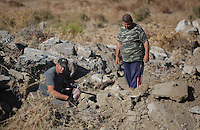 Pictured: Forensics officers conduct a preliminary search at the new site in Kos, Greece. Friday 07 October 2016<br />Re: Police teams led by South Yorkshire Police, searching for missing toddler Ben Needham on the Greek island of Kos have moved to a new area in the field they are searching.<br />Ben, from Sheffield, was 21 months old when he disappeared on 24 July 1991 during a family holiday.<br />Digging has begun at a new site after a fresh line of inquiry suggested he could have been crushed by a digger.