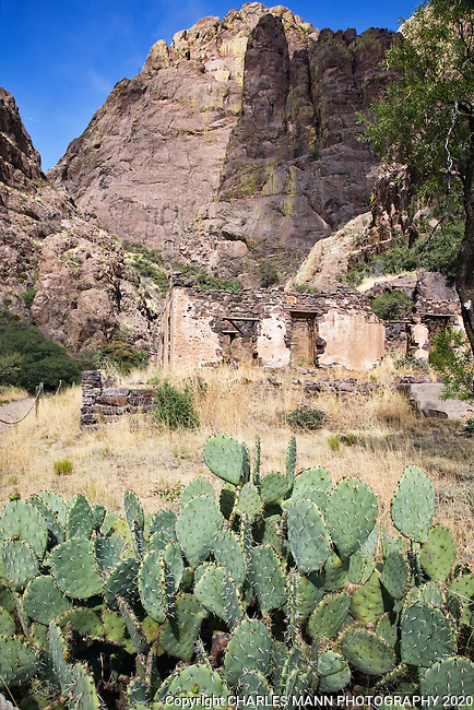Snuggled up under towering peaks, the historic ruins of the Van Patton Mountain Camp,and a turn of the century Harvey House hotel in the Organ Montains near Las Cruces, New Mexico. is a destination for hikers at Dripping Springs Natural Area.