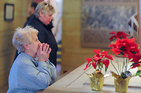 Pat Kampf of Philadelphia prays at the National Shrine of St. Katharine Drexel Thursday, December 28, 2017 in Bensalem, Pennsylvania. Drexel was an American heiress who dedicating herself to work among the American Indians and African-Americans in the western and southwestern United States. She was canonized a saint by the Roman Catholic Church in 2000. (Photo by William Thomas Cain/Cain Images)