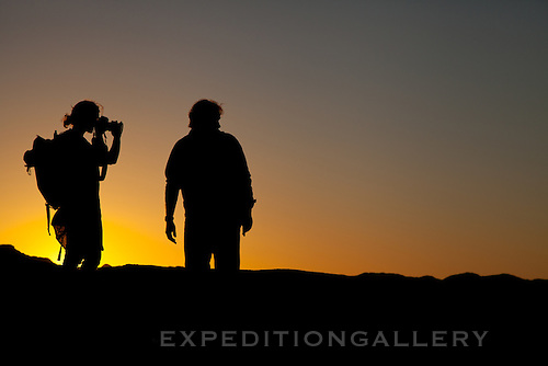 Silhouettes at sunset in the Namib Desert, Dorob National Park, Namibia.