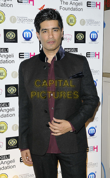 Manish Malhotra.attended the Manish Malhotra Fashion Extravaganza, Grosvenor House Hotel, Park Lane, London, England..February 23rd, 2013.half length black suit jacket maroon shirt.CAP/CAN.©Can Nguyen/Capital Pictures.