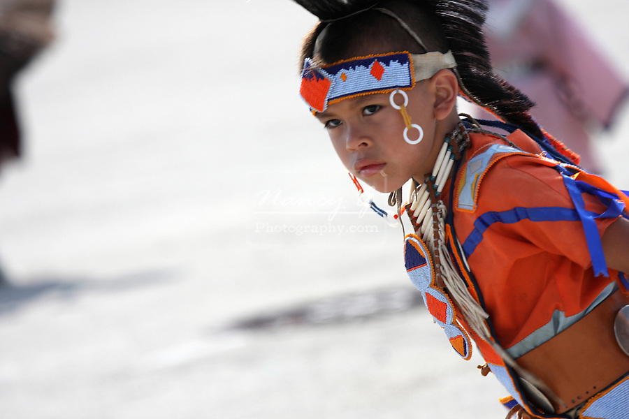 A Native American Indain boy dancing at a Pow Wow at the Milwaukee Lakefront Indian Summer Festival, Wisconsin