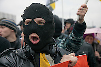 Moscow, Russia, 04/11/2010..A masked demonstrator, one of some 7,000 from the Movement Against Illegal Immigration and other ultra-nationalist groups as they march in Moscow. The demonstration, called the Russian March, was organised to mark the National Unity Day holiday, which has replaced the old holiday celebrating the Bolshevik Revolution, and which extremist nationalist groups have tried to make their own.