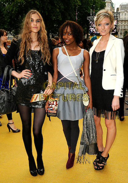 "CONTESTANTS FROM ""BRITAIN'S NEXT TOP MODEL"".Attending the UK Film Premiere of ""The Hangover"" at Vue West End Cinema, Leicester Square, London, England, UK, 10th June 2008..full length black sequined dress jacket hand on hip tights shoes sandals white blazer jacket grey gray red maroon booties ankle boots .CAP/CAN.©Can Nguyen/Capital Pictures"